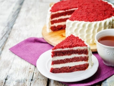 Red velvet cake on a white wood background. the toning. selective focus