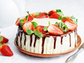 Sponge cake with cream, chocolate and strawberry. toning. selective focus